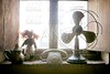 Antique vintage air fan, doll and phone