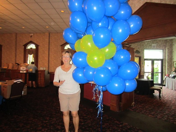 Debi Drollinger Calabrese '71 with one of the blue-gold balloon deliveries…Can you imagine fitting all of these in your car?