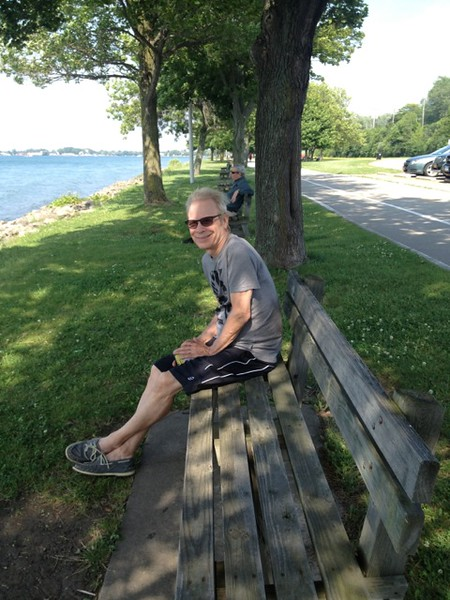 Gary Baker sitting along the Niagara River and first moment of calm, after returning the bike rental