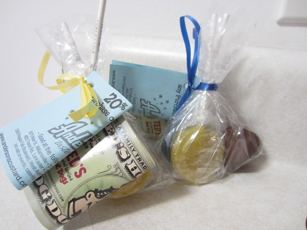 Gift bags for all with Anderson's and Ted's coupons, sponge candy and Parkside lollipops in blue (blueberry) and gold (banana)