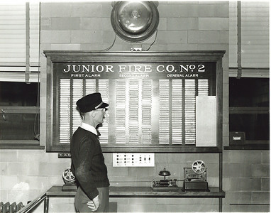 Unidentified FF in front of Junior's gamewell system in 1938.