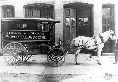 The company's ambulance in front of the building in 1897