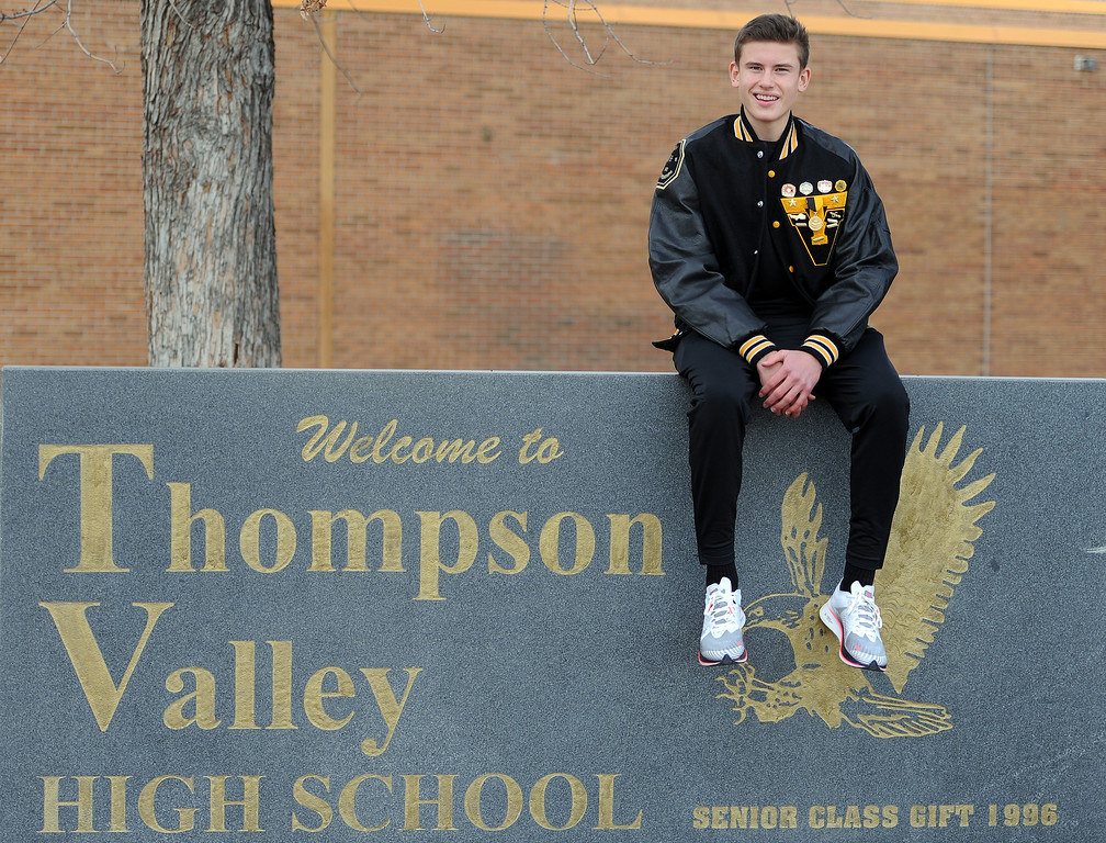 . Dylan Schubert sits in front of Thompson Valley High School after being named RH Boys Cross Country Runner of the Year. (Colin Barnard/Loveland Reporter-Herald)
