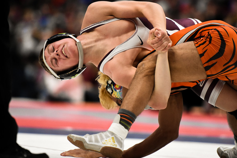 Berthoud's Kolten Strait goes for a move in his 113-pound championship match during the 3A state wrestling tournament Saturday Feb. 17, 2018 at the Pepsi Center in Denver. (Cris Tiller / Loveland Reporter-Herald)