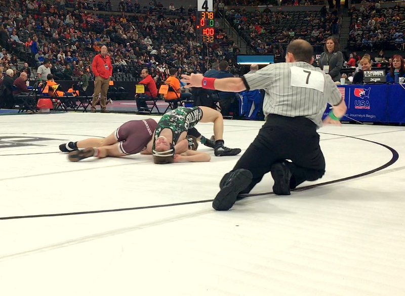 Berthoud's Austyn Binkly puts the final touches on his pin of Woodland Park's Zach Dooley in their third-place match at 106 pounds in the 3A state wrestling tournament Saturday at the Pepsi Center in Denver.
