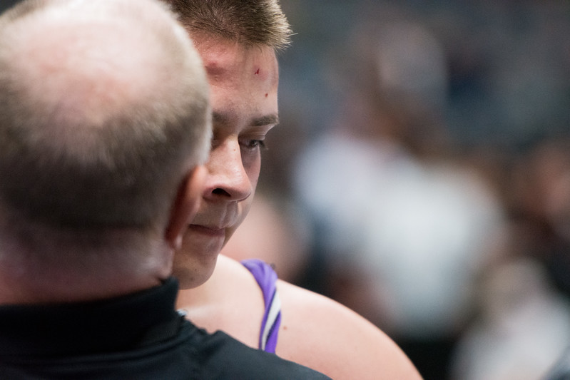 Mountain View's Martin Rodriguez is consoled by his coach after losing during the 4A state wrestling tournament Saturday Feb. 17, 2018 at the Pepsi Center in Denver. (Cris Tiller / Loveland Reporter-Herald)