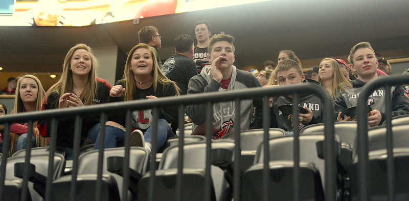 Loveland wrestlers and manager sit in the stands and cheer on Cody Thompson in the consolation semifinals. Thompson won a decision to guarantee a state medal.