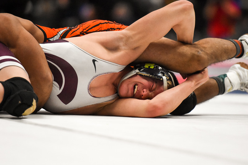 Berthoud's Kolten Strait fights off a move in his 113-pound championship match during the 3A state wrestling tournament Saturday Feb. 17, 2018 at the Pepsi Center in Denver. (Cris Tiller / Loveland Reporter-Herald)