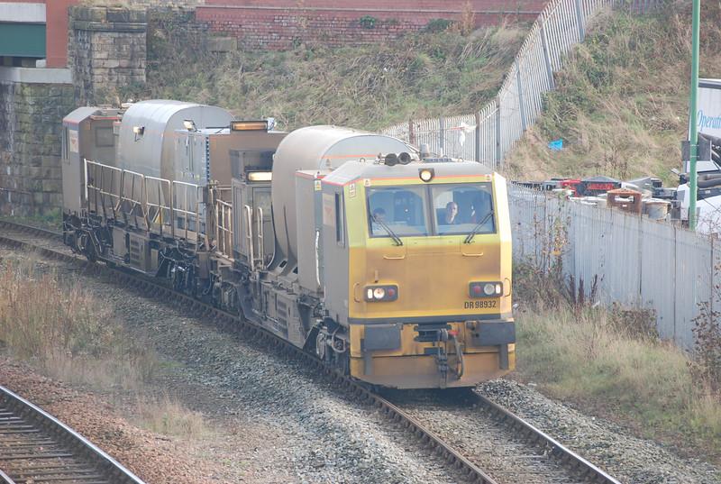 9th Nov 2014 <br /> <br /> MPV <br /> <br /> front 98932 <br /> <br /> rear 98982<br /> <br /> Multi Purpose Vehicle<br /> <br /> working <br /> <br /> 11.18 Wigan TMD - Wigan TMD <br /> <br /> via Southport / Manchester / Hebden Bridge / Stalybridge / Huddersfield / Bolton / Blackburn / Preston / Blackpool South / Wigan TMD <br /> <br /> Seen approaching Windsor Road Bridge in Southport