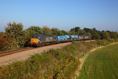 57003 tnt 57002 on the 3S01 Stowmarket circular via Cromer, Great Yarmouth and Ely departing Cromer at East Runton on the 10th October 2018