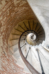 Spiral staircase behind a door in a corner in the State Room