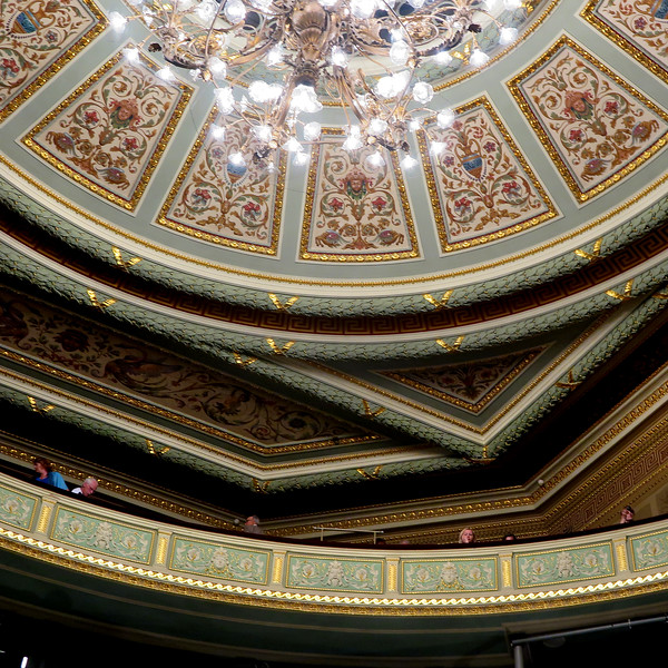 The decorated ceiling and the upper balcony in the auditorium of Latvian Opera House, Riga