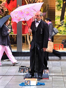 Crooner With A Table Cloth Coloured Umbrella!