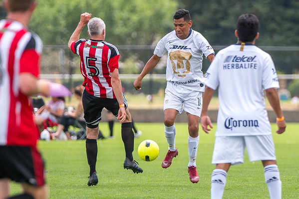 Perros Viejos vs the Boulder Blades during the Rocky Mountain Adult Soccer Tournament at Pleasant View Soccer Fields in Boulder, Colorado on July 27, 2019.
