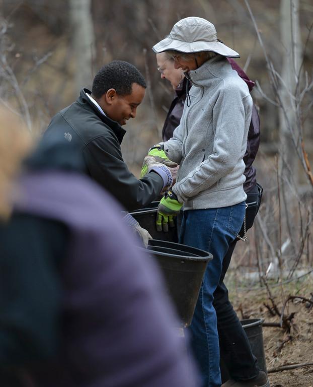 . Joe Neguse and an Estes Park resident share a laugh.