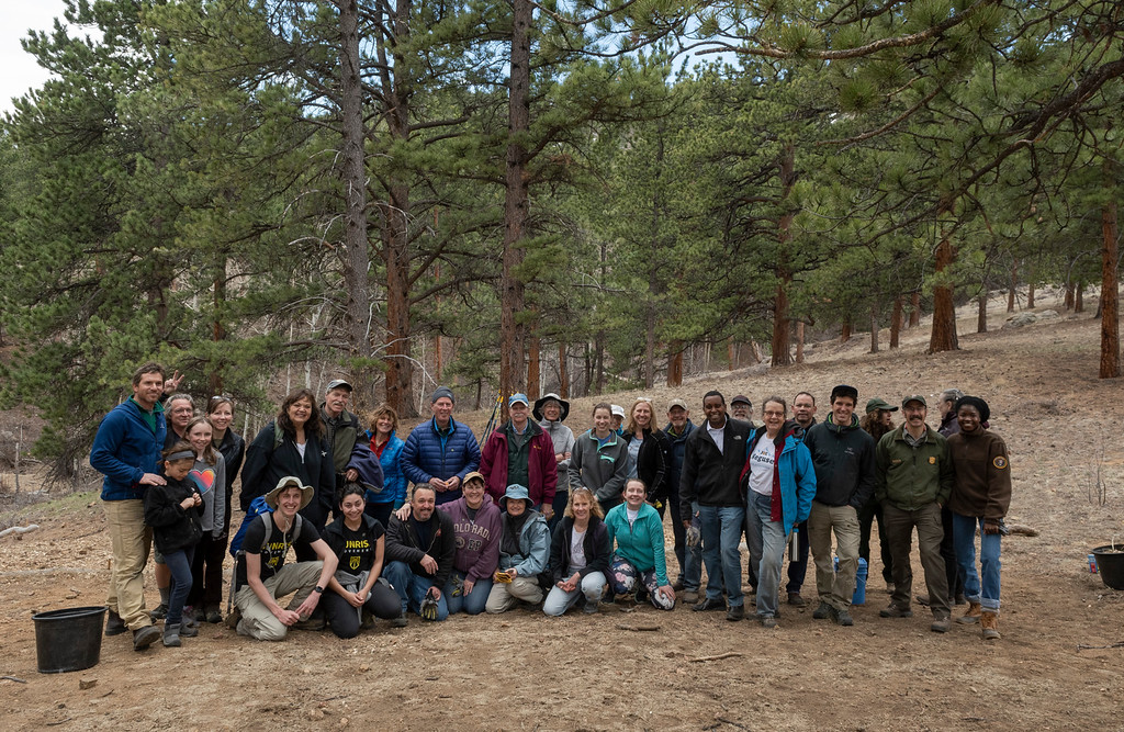 . Neguse and the group of volunteers who helped seed and mulch some land in Rocky Mountain National Park pose for a photo.