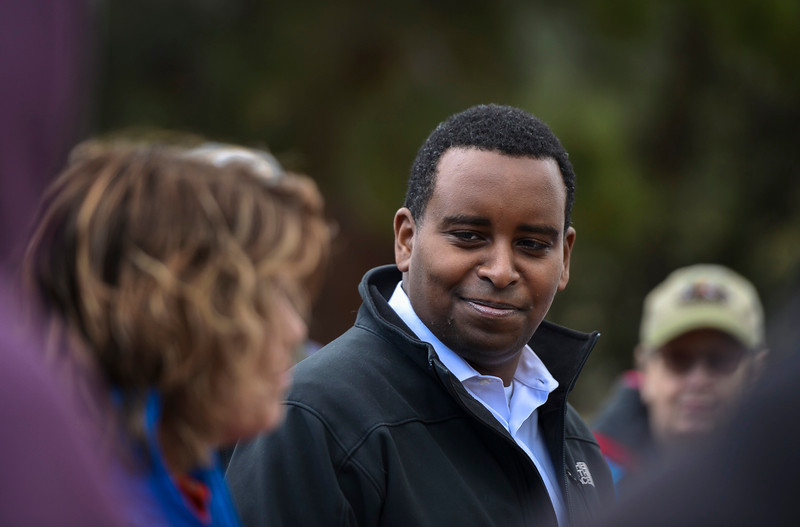 Darla Sidles, superintendent of Rocky Mountain National Park, discusses with Colorado Congressman Joe Neguse some seeding and mulching work that needs to be done to an area near the Beaver Meadows Visitor Center before Neguse and his constituents got to work on April 20, 2019.