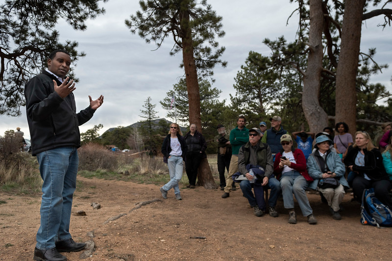 Colorado Congressman Joe Neguse, left, addresses his constituents during a Town Hall at the Beaver Meadows Visitor Center on April 20.