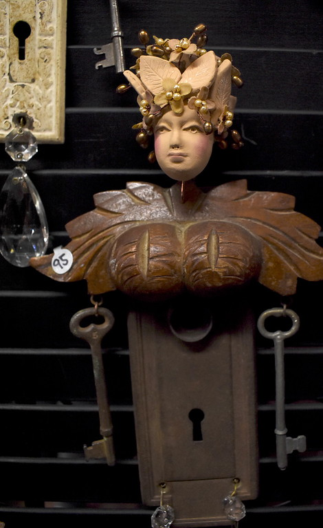 ". A ""wall angel\"" mixed media sculpture created from antique door plates, skeleton keys, and drawer pulls by artist Ann Marie Fischer, Farmington Hills.  Visitors browse the jewelry, ceramics, glass, painting, sculpture and other works of 60 juried artists at the 2nd annual Spring Art Fair at the Farmers Market in Royal Oak, Michigan on April 5, 2018. Hosted by The Guild of Artists and Artisans, the event, which runs Friday April 6 from noon to 10pm, kicks off the Art Fair season and includes music, food trucks and craft beverages. Officials expect roughly 7,000 people to attend the 2-day event.  (Photo by Brandy Baker)"