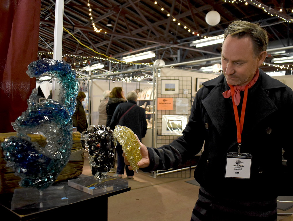 . Visitors browse the jewelry, ceramics, glass, painting, sculpture and other works of 60 juried artists at the 2nd annual Spring Art Fair at the Farmers Market in Royal Oak, Michigan on April 5, 2018. Hosted by The Guild of Artists and Artisans, the event, which runs Friday April 6 from noon to 10pm, kicks off the Art Fair season and includes music, food trucks and craft beverages. Officials expect roughly 7,000 people to attend the 2-day event.  (Photo by Brandy Baker)
