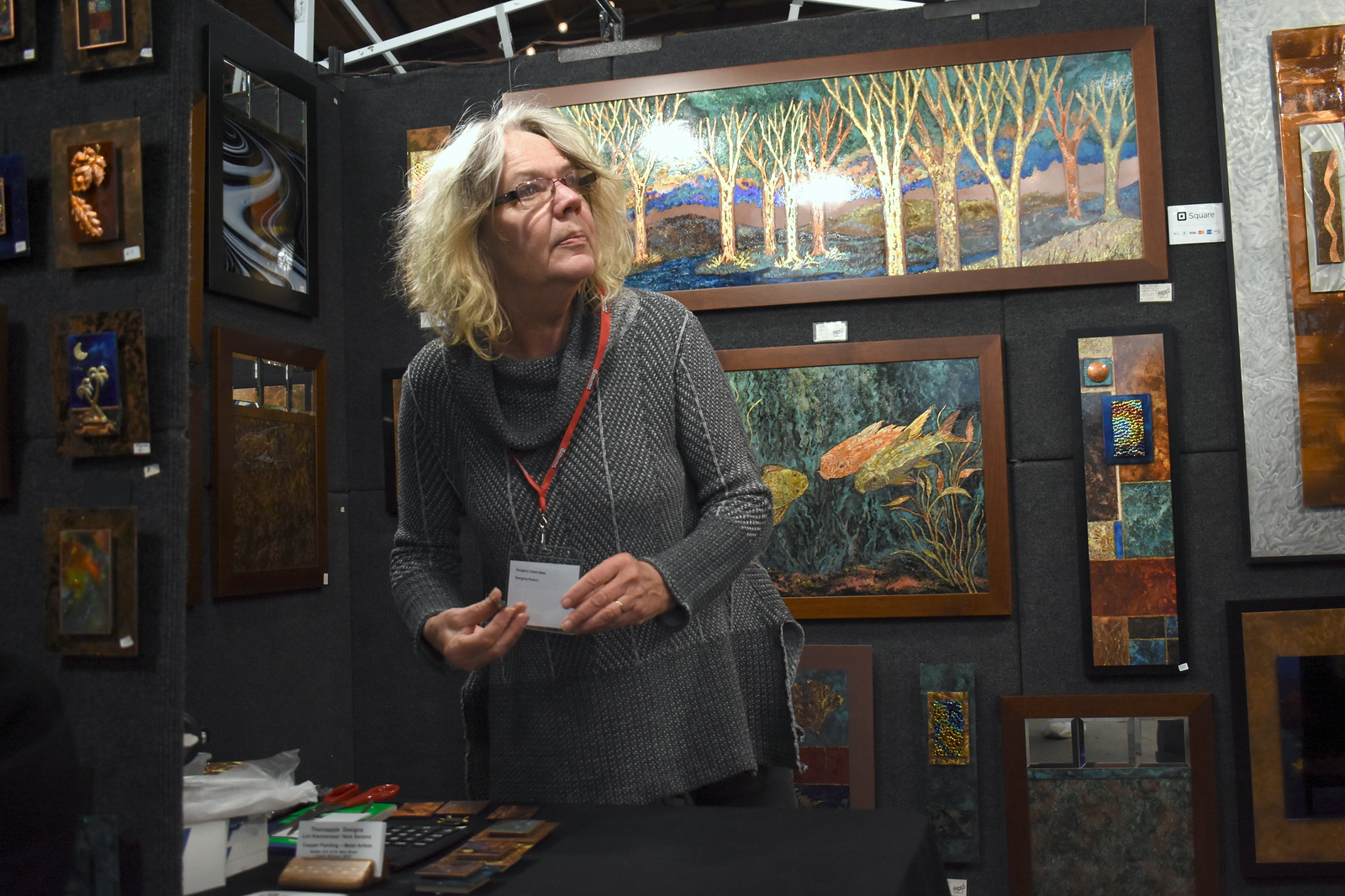Visitors browse the jewelry, ceramics, glass, painting, sculpture and other works of 60 juried artists at the 2nd annual Spring Art Fair at the Farmers Market in Royal Oak, Michigan on April 5, 2018. Hosted by The Guild of Artists and Artisans, the event, which runs Friday April 6 from noon to 10pm, kicks off the Art Fair season and includes music, food trucks and craft beverages. Officials expect roughly 7,000 people to attend the 2-day event.  (Photo by Brandy Baker)