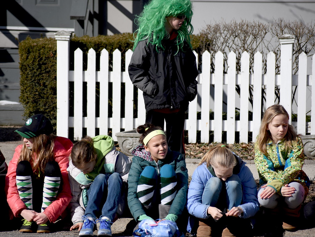 . Dressed in their best green looks, spectators watch the annual St. Patrick\'s Day Parade in Royal Oak, Michigan on March 10, 2018. (Photo by Brandy Baker)
