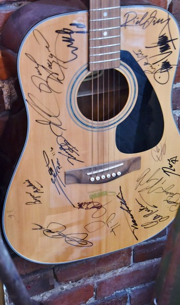 Guitar,  where all inclusive is all exclusive. .<br /> .Several famous personalities have autographed this. <br /> However, you can't read any of them!!! ..What a waste of Sharpie Ink!