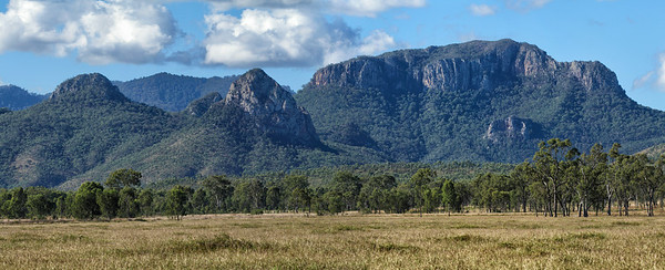 Late afternoon pano of the Marling Spikes, with the Sydney Heads behind them. The Homevale National Park is near Nebo, Central Queensland. Four shot pano.