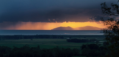 Showers at sunrise, over Keswick Island. Image shot from our front patio.