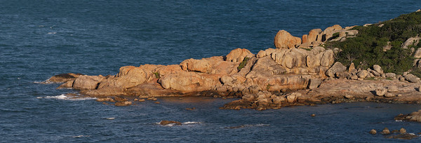 Bowen,  Murray Bay rocky outcrop at sunset. Multiple shot panorama. Taken from Horseshoe Bay Lookout.