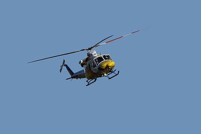 The rescue helicopter making a very low pass over our house, before landing at the neighbour's 250 m away, to assist a road accident victim. Shot late afternoon. Unimaginably deafening.