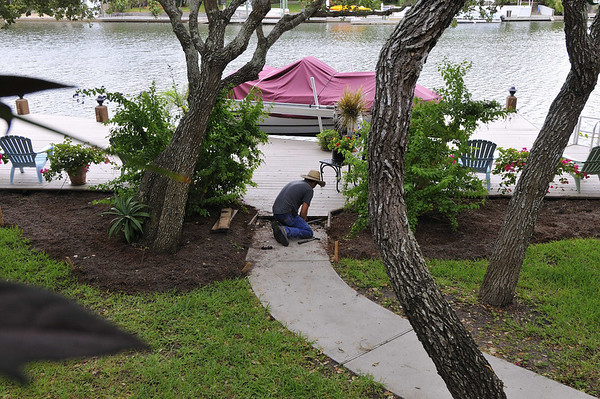 Dustin getting walk preped for pavers, new beds at the dock
