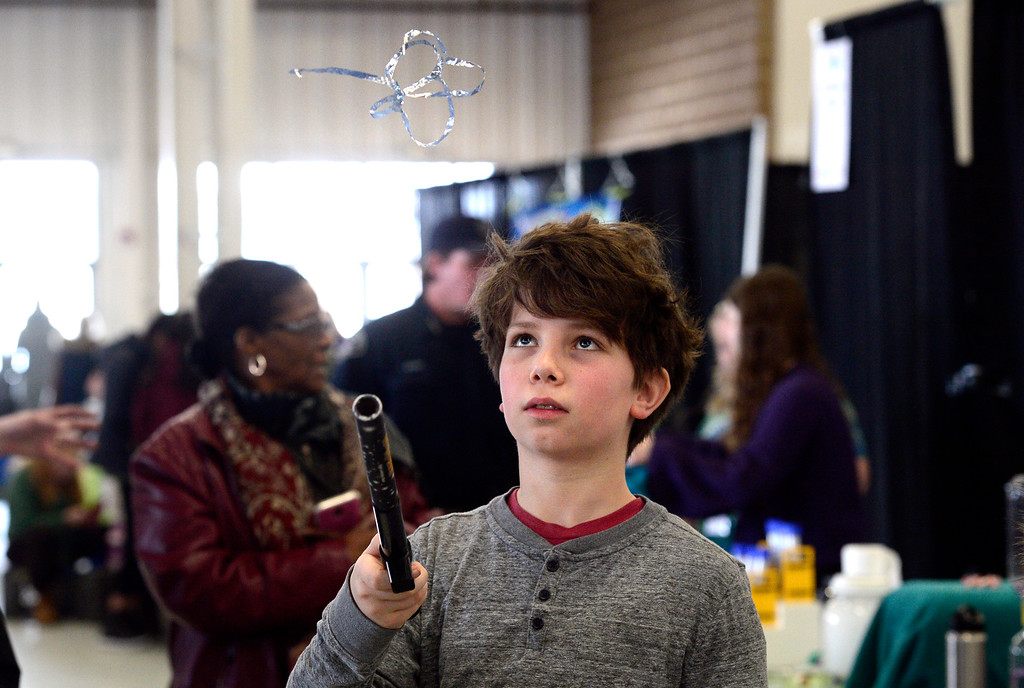 . LONGMONT, CO - MARCH 3, 2019 Finlay Patterson, 12, tries out the Fun Fly Stick Magic Levitation Wand at the Exploration Universe Booth at Rocky Mountain STEAM Fest 2019 at the Boulder County Fairgrounds in Longmont on March 3, 2019. The wand uses static electricity to keep objects suspended above it.  For more photos go to timescall.com. Paul Aiken / For the Camera