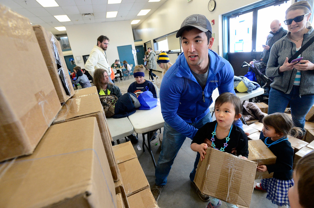 . LONGMONT, CO - MARCH 3, 2019 Spencer James prepares to lift his daughter Heidi, 4, up to the top of a cardboard box wall they are building at Rocky Mountain STEAM Fest 2019 at the Boulder County Fairgrounds in Longmont on March 3, 2019. Cora James, 2, waits her lift up at right.  For more photos go to timescall.com. Paul Aiken / For the Camera