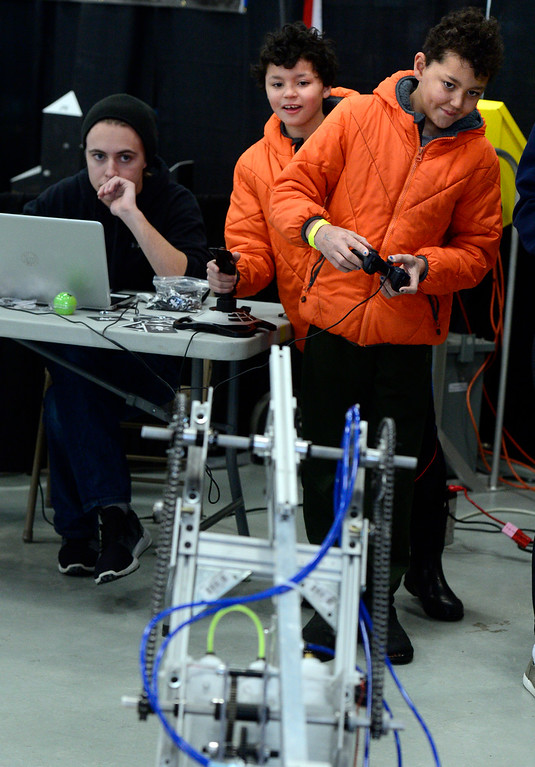 . LONGMONT, CO - MARCH 3, 2019 Twins Liam, left, and Cooper Keene, both 11, work together to get a robot to pick up a ball at the RC Dawson school\'s robot exhibit at Rocky Mountain STEAM Fest 2019 at the Boulder County Fairgrounds in Longmont on March 3, 2019.  For more photos go to timescall.com. Paul Aiken / For the Camera