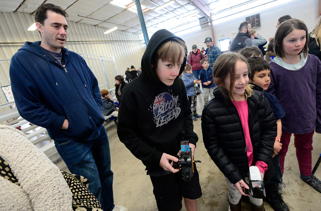 . LONGMONT, CO - MARCH 3, 2019 Ethan Buchanan, 12, at left, battles his sister Grayce, 8, in a robot challenge at Rocky Mountain STEAM Fest 2019 at the Boulder County Fairgrounds in Longmont on March 3, 2019.  For more photos go to timescall.com. Paul Aiken / For the Camera