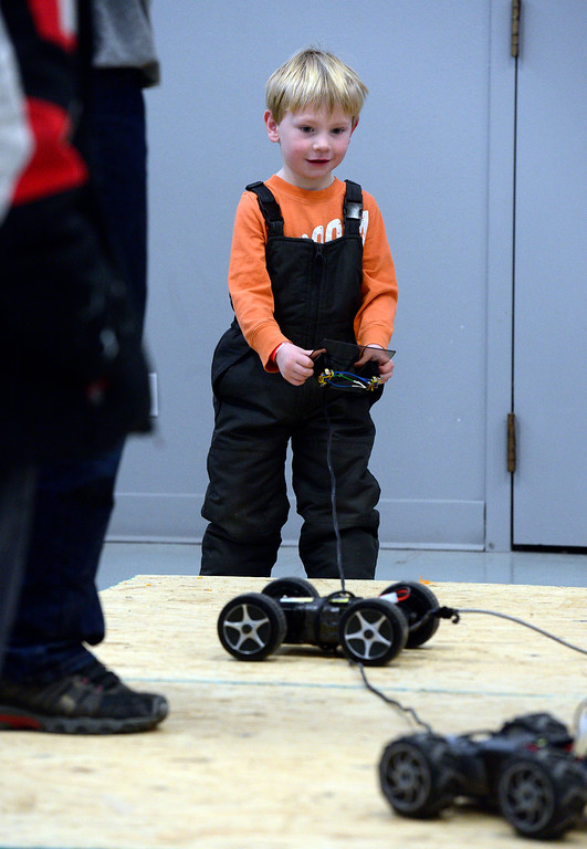 . LONGMONT, CO - MARCH 3, 2019 Boston Ratcliffe, 4, battles with some remote control cars at Rocky Mountain STEAM Fest 2019 at the Boulder County Fairgrounds in Longmont on March 3, 2019.  For more photos go to timescall.com. Paul Aiken / For the Camera
