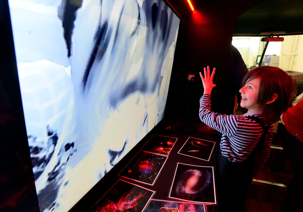 . LONGMONT, CO - MARCH 3, 2019 Patrick Cisneros, 8, explores the infrared cameras that turn body heat into images on the screen in the MESO - Mobile Earth & Space Observatory exhibit at Rocky Mountain STEAM Fest 2019 at the Boulder County Fairgrounds in Longmont on March 3, 2019.  The MESO is part of the National Space Science & Technology Institute based in Colorado Springs.  For more photos go to timescall.com. Paul Aiken / For the Camera
