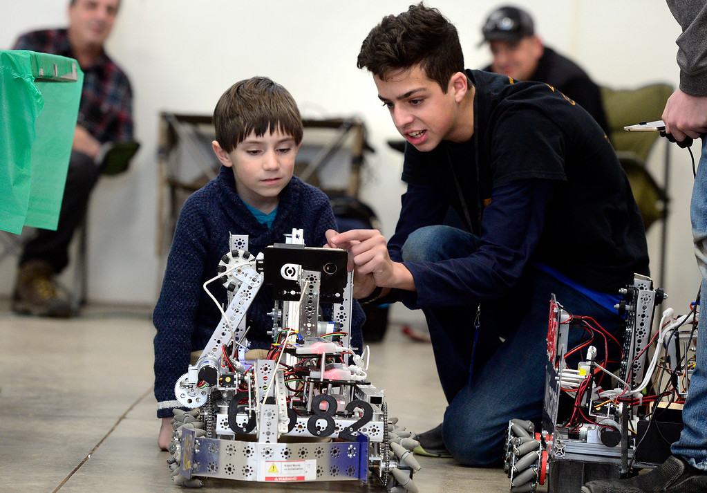 . LONGMONT, CO - MARCH 3, 2019 Liam Buchanan, 7, at left, gets some tips on how to run a robot from Dominic Spina, in the First Tech Challenge robotics booth at Rocky Mountain STEAM Fest 2019 at the Boulder County Fairgrounds in Longmont on March 3, 2019.  For more photos go to timescall.com. Paul Aiken / For the Camera