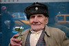 War veteran selling ghiocei (snowbells)  flowers in Bucharest