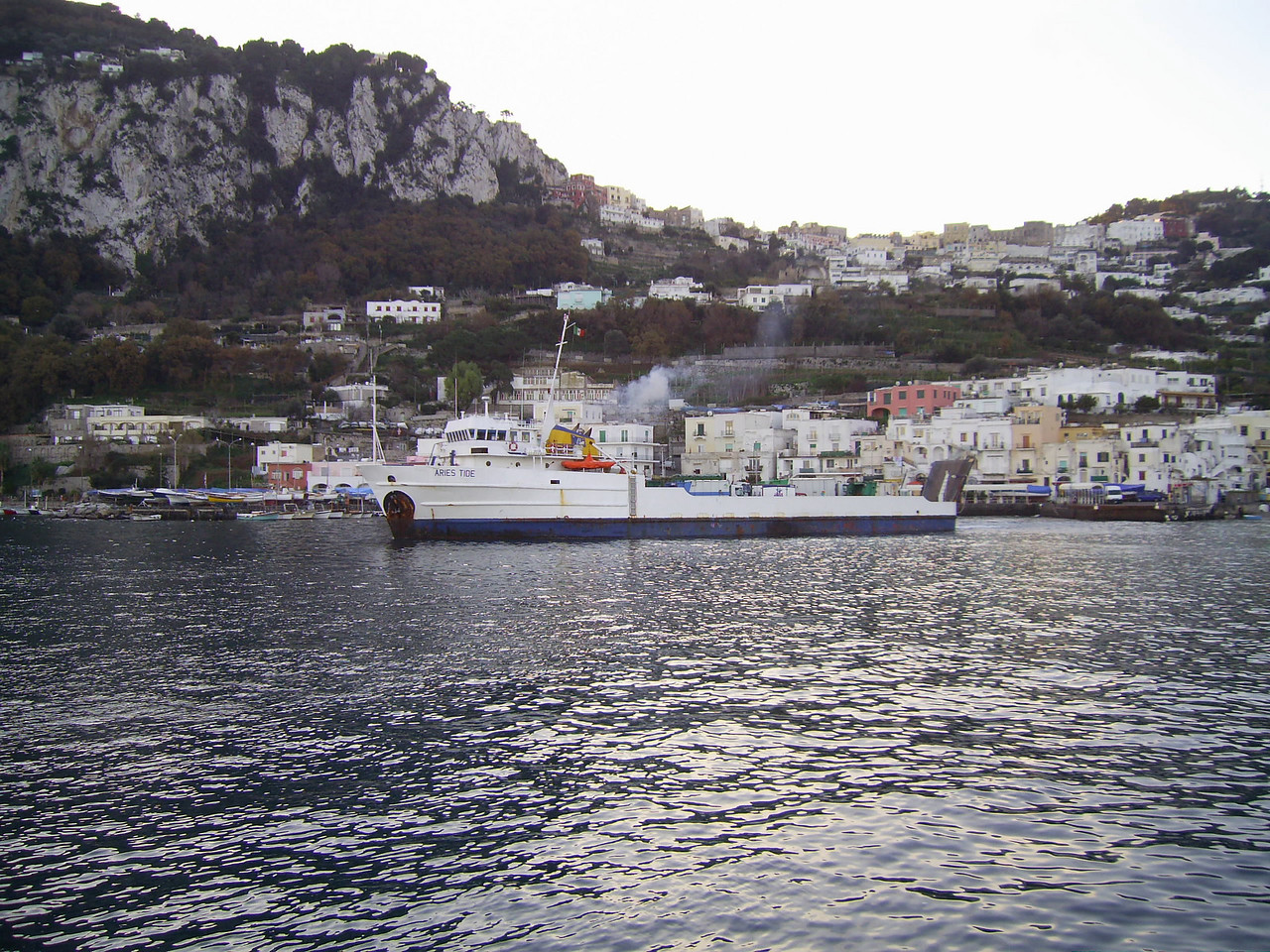 M/S ARIES TIDE departing from Capri. An old offshore supply ship used for garbage, oil and special transports between Napoli and Capri island.