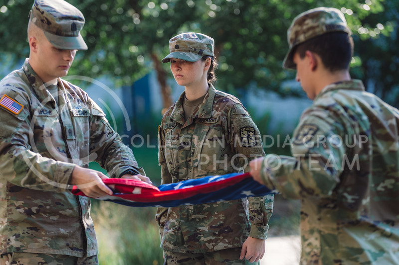 Gabriela Olivier, Gunnar Ehlers, Matt Ebenstein displaying and escorting our nation's flag at Gen. Richard B. Myers Hall on Monday Sep 20, 2021. (Dylan Connell   Collegian Media Group)