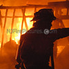 "Roxbury, NJ 189 Emmans Road April 18, 2008 : Around midnight on April 18th Roxbury Firefighters responded to 189 Emmans Road on a reported shed fire. Upon arrival fireifghters found heavy fire showing from a 20x20 wood frame out building as well as a small shed. The extensive heat caused the vinyl siding to melt off of two dwellings and also caused damage to car parked in the driveway. All three Roxbury Fire Companies operated at the scene. Photos By: Tommy ""Marbles"" Bilancia"
