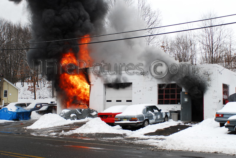 Heavy fire showing from an autobody shop. Photo By: Adam Alberti