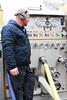 Ladder 101 pump operator Jeff Poissant watching his pressures. Photo By: Adam Alberti
