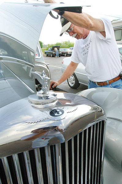 Photo and caption as it appeared in the Jackson, MS newspaper. Sneed Adams takes a peek under the hood of his 1953 Bentley R-Type before he and a pair of Rolls-Royce drivers prepare to hit the road after gassing up at the Flying J Truck Stop on US 80 in Pearl on Friday morning.  The group is headed to Asheville, NC for the Rolls-Royce Owners'Club National Spring Tour, during which participants will spend six days driving through the Smoky Mountains.