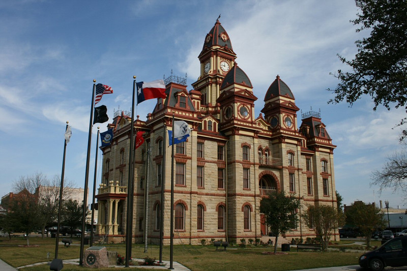 We motored from San Marcos to Lockart for lunch. Lockhart is the county seat of Caldwell County and this is the Courthouse.  The Caldwell County courthouse was built in 1894 of Second Empire architecture.  It was designed by Alfred Giles and built by William Martin with white limestone trimmed with red sandstone for a total cost of $54,850.00.
