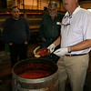 Tony explains the pepper grinding and fermenting process which takes place in oak barrels.