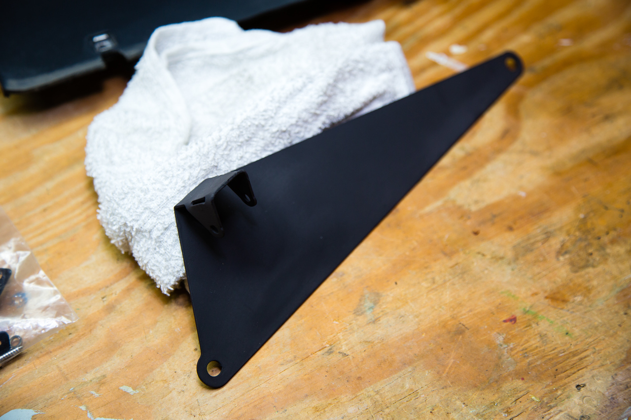 Repainted backup camear mount plate.