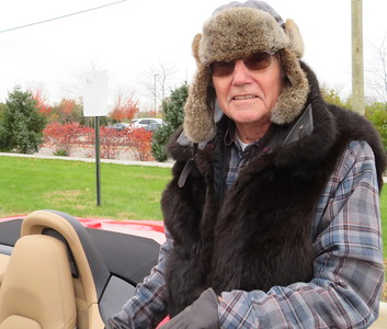 Doug Ash is well prepared for an open top ride in November.